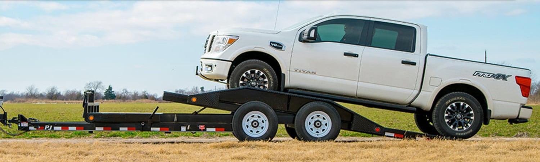 White pickup truck on a PJ tilt trailer